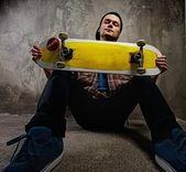 Young man with a skateboard — Stok fotoğraf
