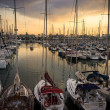 Yachts and boats in harbour on sunset - Stock Photo