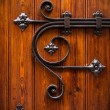 Wooden door with metal decoration - Stock Photo
