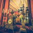 Antique clock and chandelier against mirror — Foto de Stock
