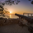 Old rusty cannon at sunset - Stock Photo