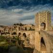Romanesque bridge over river, Besalu - Stock Photo