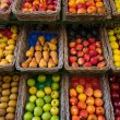 Fruits in baskets on market place - Stock Photo