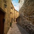 Narow street in Besalu, Spain - Stock Photo