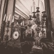 Antique clock and chandelier against mirror — Stok fotoğraf