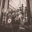 Stock Photo: Antique clock and chandelier against mirror