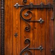 Wooden door with metal decoration — Stock Photo