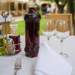 Table setting with bottle of wine in restaurant - Stok fotoğraf