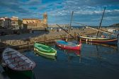 Four colorful boats near pier in Collioure bay — Stock Photo