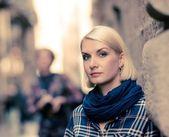 Beautiful blond woman wearing blue scarf outdoors — Stock Photo