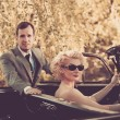 Retro couple and convertible - Stock Photo