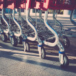 Empty shopping trolleys - Stock Photo
