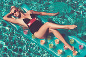 Pin up girl in the swimming pool — Stock Photo
