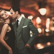 Retro couple over blurred background — Stock Photo