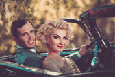 Retro couple in convertible — Stock Photo