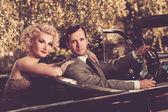 Retro couple in convertible — Stock Photo
