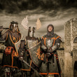 Royalty-Free Stock Photo: Three knight in armor against Romanesque bridge over river , Besalu