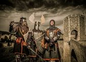 Three knight in armor against Romanesque bridge over river , Besalu — Stock Photo