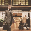 Man in classic grey suit with briefcase in airport - ストック写真