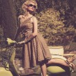 Stock Photo: Womin retro dress with scooter