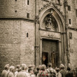 Group of near cathedral entrance — Stock Photo #15657883