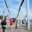 Walking on Rambla de Mar in Barcelona, Spain - 
