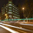Stock Photo: Street of Barcelona at night wtih blurred cars
