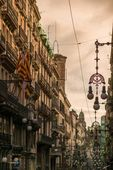 Street in Barcelona with many streetlights — Stock Photo