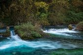 Weirs on river in Fontaine-de-Vaucluse, France — Stock Photo