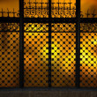 Decorative metal grating on window - Stock Photo