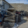 Riggings behind oysters shacks in Port Leucate, France - Stock Photo