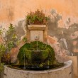 Stock Photo: Drinking fountain in wall