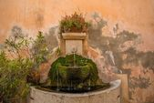 Drinking fountain in wall — Stock Photo