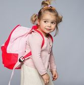 Funny little girl with backpack — Stock Photo
