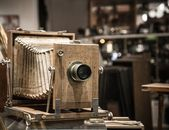 Retro wooden photo camera — Stock Photo