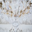 Antique crystal  lamp against wall with stucco work — ストック写真