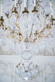 Antique crystal lamp against wall with stucco work — Stock Photo