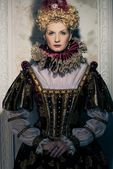Haughty queen in royal dress — Stock Photo