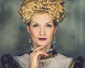 Portrait of beautiful haughty queen in royal dress — Stock Photo
