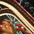 Carousels in amusement park at night - Stok fotoğraf