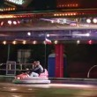 Carousel with cars & motorcycles in amusement park — Stock Video