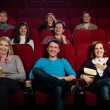 Group of young in cinema — Stock Photo