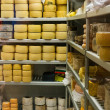 Shelves full of different cheese - Stock Photo