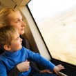 Young mother with her little son traveling on train — Stock Photo
