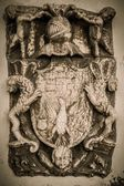 Coat-of-arms made from stone — Stock Photo