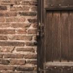 Old wooden door in brick wall — Stock Photo #25852059