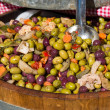 Different colourful olives in barrel — Stock Photo