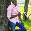 Young black guy in park — Stock Photo #25852401