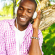 Young black guy in park — Stock Photo