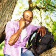 Young black guy in park — Stock Photo #26309697